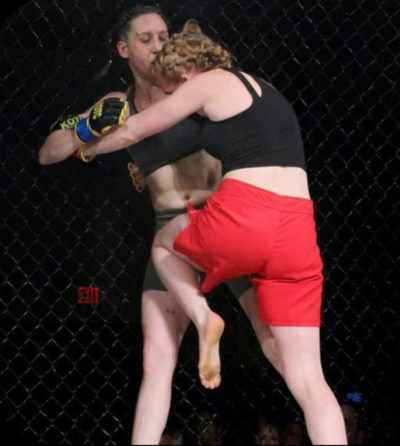 Moriel, an MMA fighter, delivers a kick to her opponent